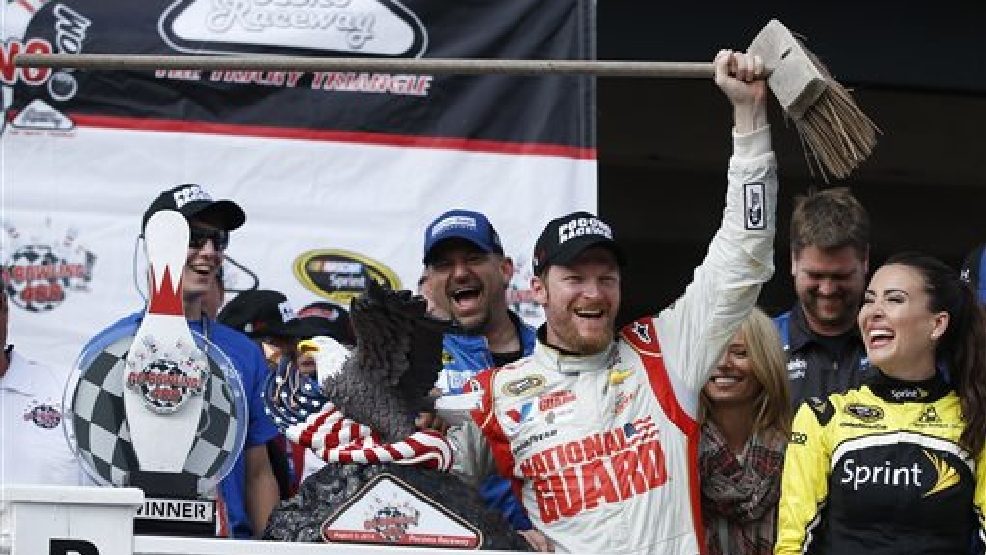 Dale Earnhardt Jr. poses with a broom in Victory Lane after winning the NASCAR Sprint Cup Series auto race at Pocono Raceway, Sunday, Aug. 3, 2014, in Long Pond, Pa. Earnhardt won both of the NASCAR races at Pocono this year. (AP Photo/Matt Slocum)