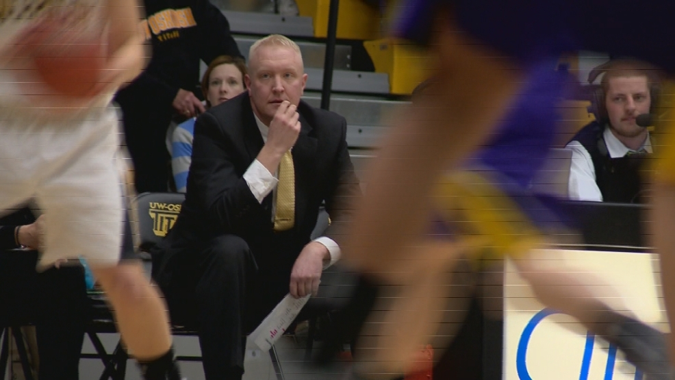 UW-Oshkosh head coach Brad Fischer watches his team from the bench.