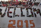 Indian students form numbers representing the year 2015 during a function to welcome the New Year at a school in Ahmadabad, India, Wednesday, Dec. 31, 2014. (AP Photo/Ajit Solanki)