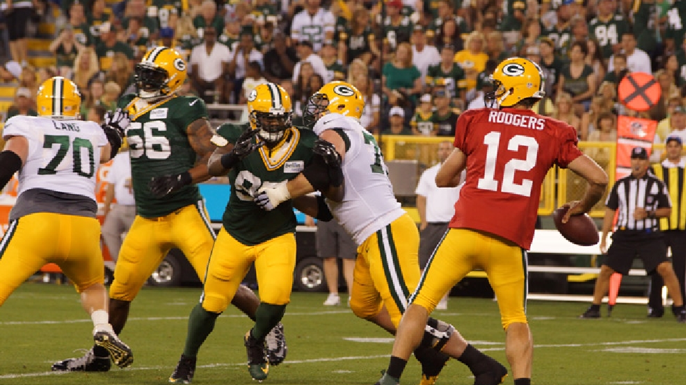 Aaron Rodgers makes a throw during Packers Family Night, presented by Bellin Health, Aug. 2, 2014, at Lambeau Field. (WLUK/Juli Buehler)