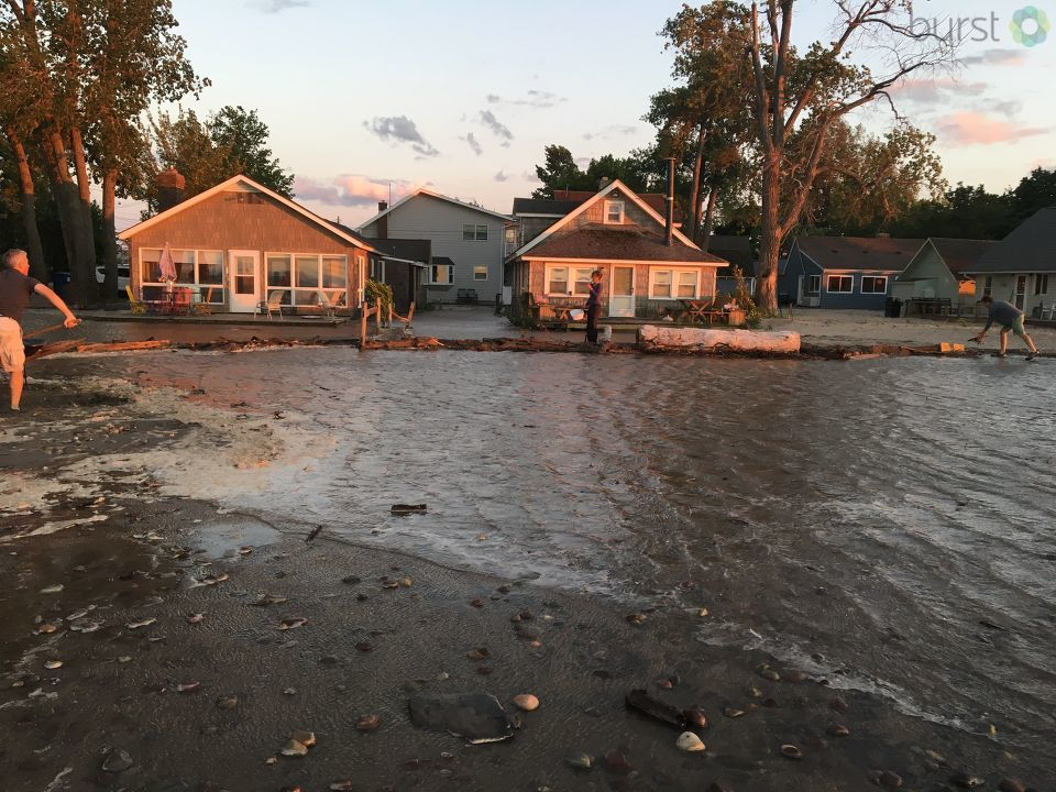 Homeowners along the shoreline of Sodus Point work to prevent flooding caused by large waves from reaching their homes.