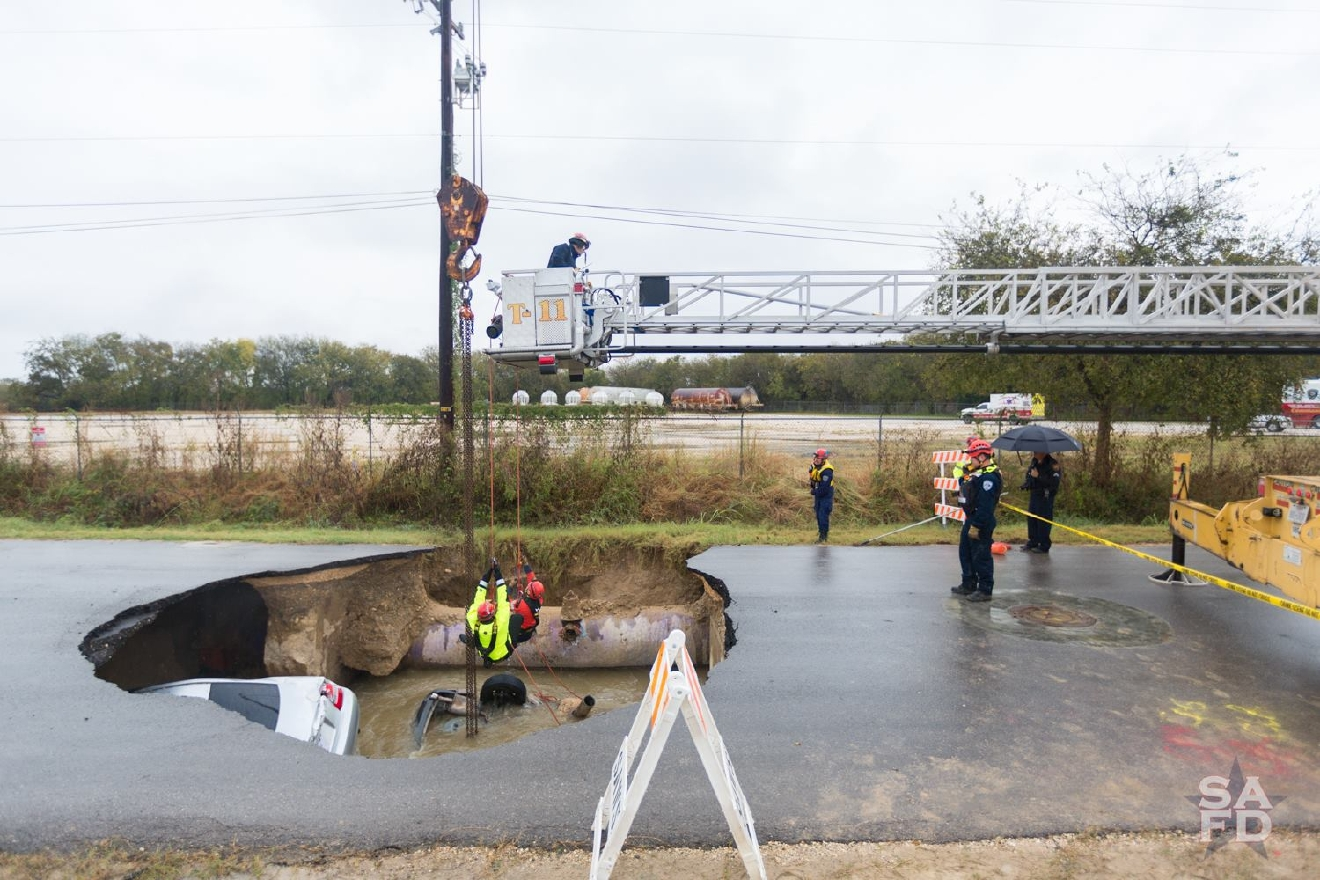 Members from Rescue 11s and SAWS worked together to recover vehicles swallowed by sinkhole. (Courtesy: San Antonio Fire Department)