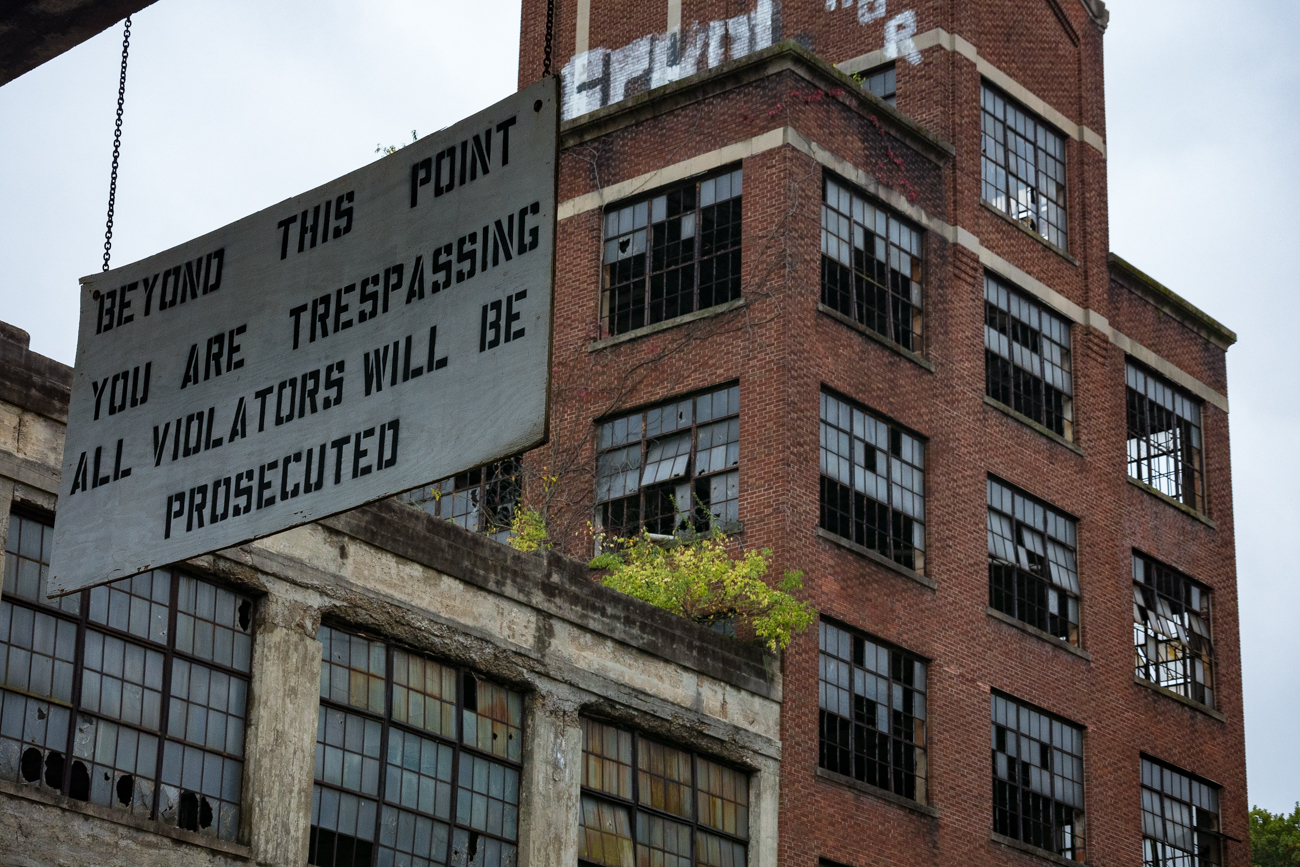 Because it is under development, signs warn trespassers not to breach the old factory's threshold. / Image: Phil Armstrong, Cincinnati Refined // Published: 10.13.17