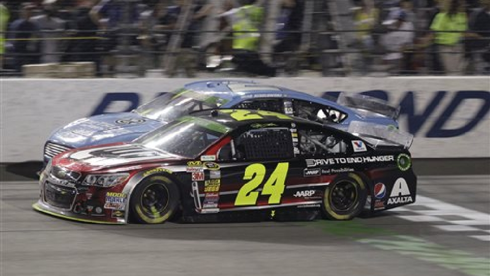 Jeff Gordon (24) and Brad Keselowski (2) battle for position on the front stretch in the closing laps during the NASCAR Sprint Cup auto race at Richmond International Raceway in Richmond, Va., Saturday, April 26, 2014. (AP Photo/Steve Helber)