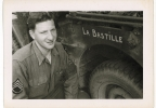 This photo dated July 1944 and provided by Dargols' family shows Bernard Dargols posing next to a Willys MB U.S. Army Jeep in Normandy, France. (AP Photo/Courtesy of Bernard Dargols' family)