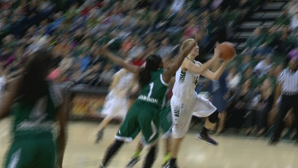 Mariah Monke drives to the hoop for Green Bay.