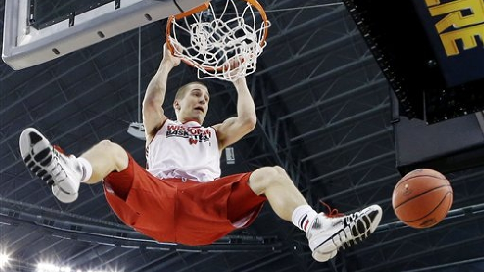 Wisconsin guard Ben Brust dunks the ball during practice for an NCAA Final Four tournament college basketball semifinal game Friday, April 4, 2014, in Dallas. Wisconsin plays Kentucky on Saturday, April 5, 2014. (AP Photo/Eric Gay)