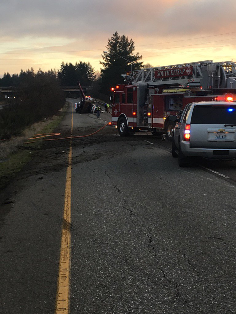 The State Patrol is investigating after a stolen truck hauling a trailer with an excavator on it overturned on eastbound State Route 16 near Port Orchard Monday afternoon. (Photo: Washington State Patrol)