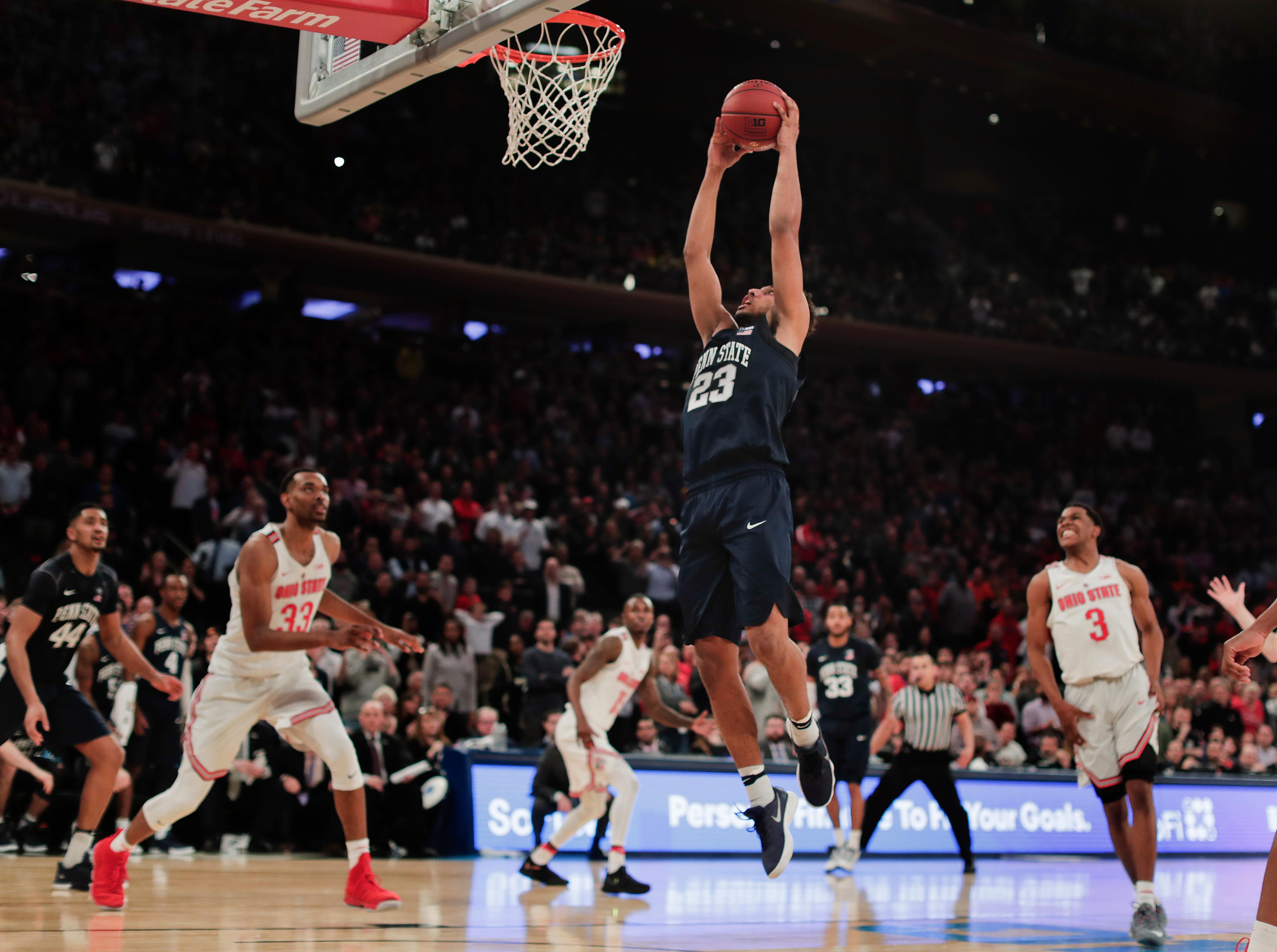 Penn State guard Josh Reaves (23) goes up for the go-ahead basket against Ohio State during the second half of an NCAA Big Ten Conference tournament college basketball game, Friday, March 2, 2018, in New York. Penn State won 69-68. (AP Photo/Julie Jacobson)