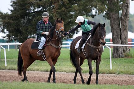 Janet Elliot (right) spends January through May training race horses in Camden.