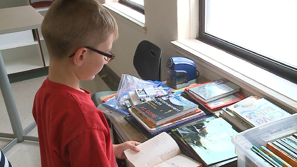 Fifth-grader Lawrence O'Neil reads a book at the Da Vinci School for the Gifted in Green Bay on Wednesday, August 27, 2014.