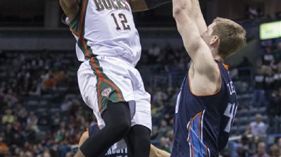 Milwaukee Bucks' Jeff Adrien shoots over Charlotte Bobcats' Cody Zeller during the second half of an NBA basketball game on Sunday, March 16, 2014, in Milwaukee. The Bobcats defeated the Bucks 101-92. (AP Photo/Tom Lynn)