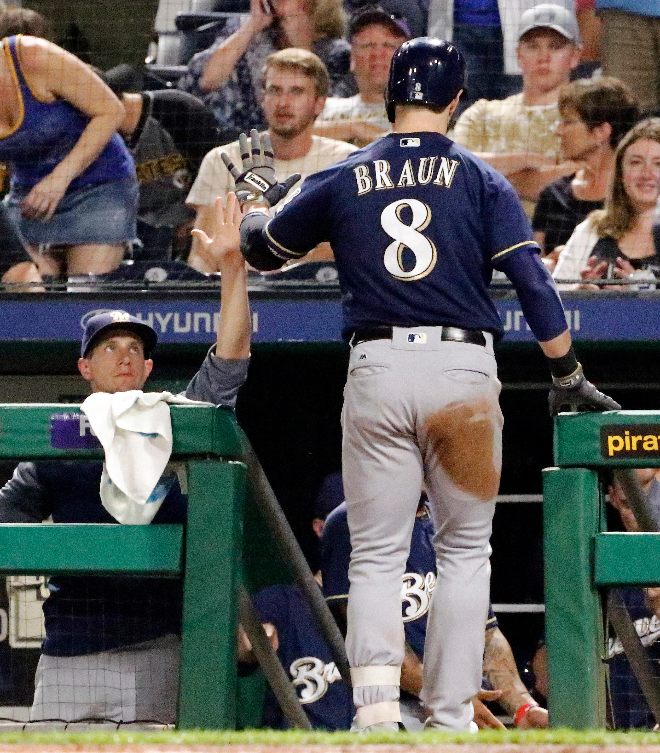 Milwaukee Brewers' Ryan Braun (8) is greeted at the dugout steps by manager Craig Counsell after hitting a solo home run off Pittsburgh Pirates starting pitcher Jameson Taillon in the fourth inning, Monday, Sept. 18, 2017 in Pittsburgh. (AP Photo/Gene J. Puskar)
