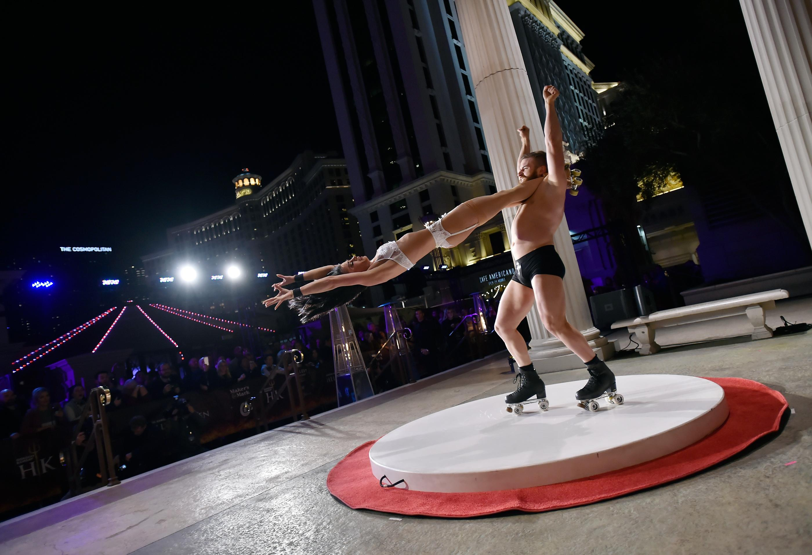 Roller skaters Emily England, left, and Billy England from the show 'Absinthe' perform during the grand opening of Gordon Ramsay Hell's Kitchen at Caesars Palace Friday, Jan. 26, 2018, in Las Vegas. CREDIT: David Becker/Las Vegas News Bureau