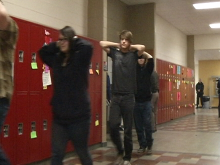 Students participate in an active shooter drill at Addison High School.