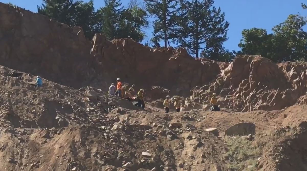 Crews worked to rescue a man who became trapped under a tractor Thursday. (KTVL)