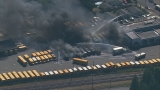Dozens of school buses destroyed as Puyallup bus barn erupts in flames, explosions
