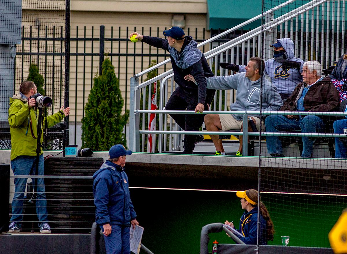 A man in the crowd catches a foul ball. The Oregon Ducks defeated the Cal Golden Bears 2-1 in the second game of the three game series. Photo by August Frank, Oregon News Lab