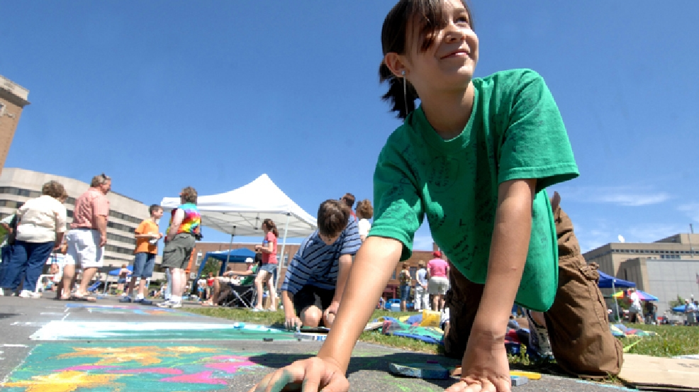 ** FILE ** Madeline Kara Neumann, of Weston, Wis., is shown working on chalk art last summer during downtown Wausau's Chalk Fest. (AP Photo/Wausau Daily Herald,Butch McCartney)