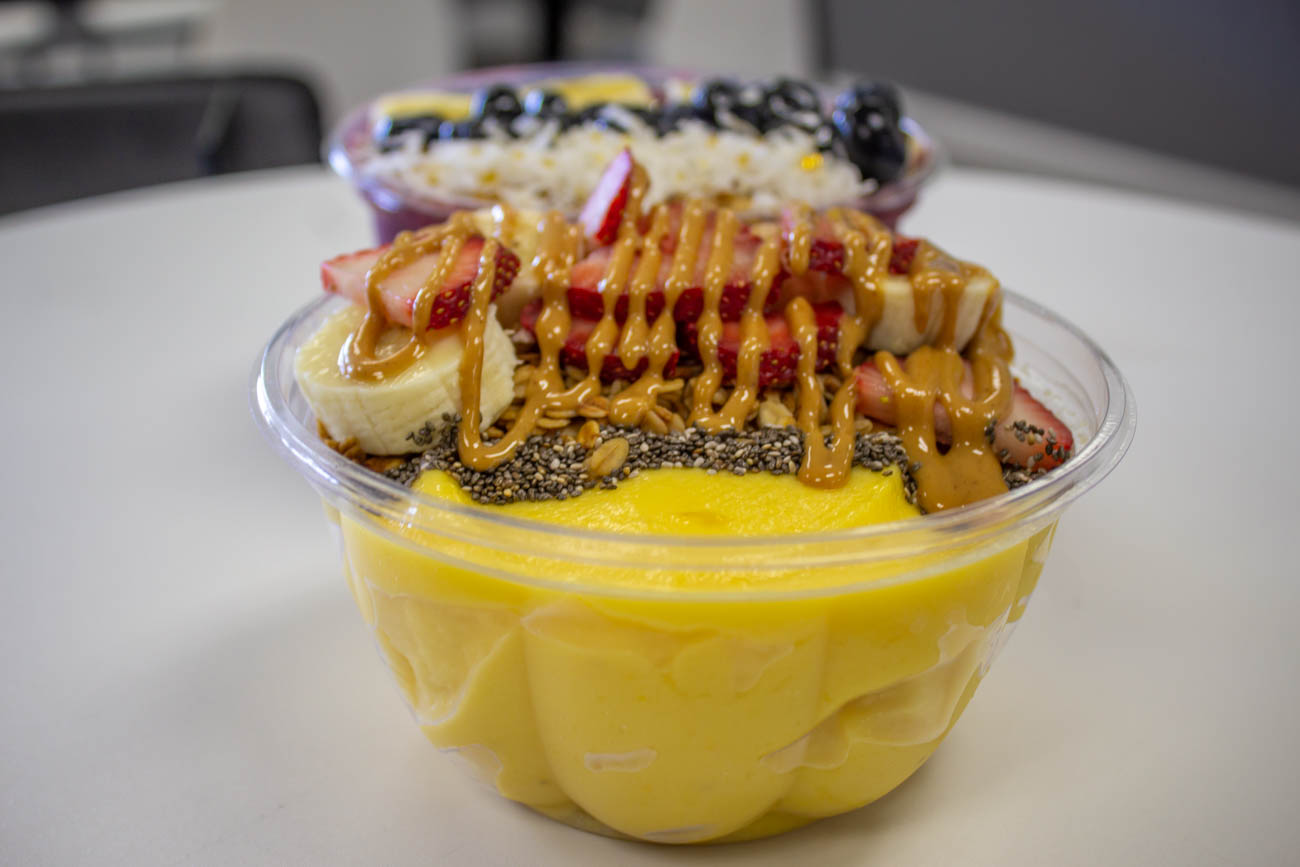 Sunnyside Bowl: pureed pineapple and mango with banana, chia seeds, oats, and peanut butter / Image: Katie Robinson, Cincinnati Refined // Published: 11.18.19