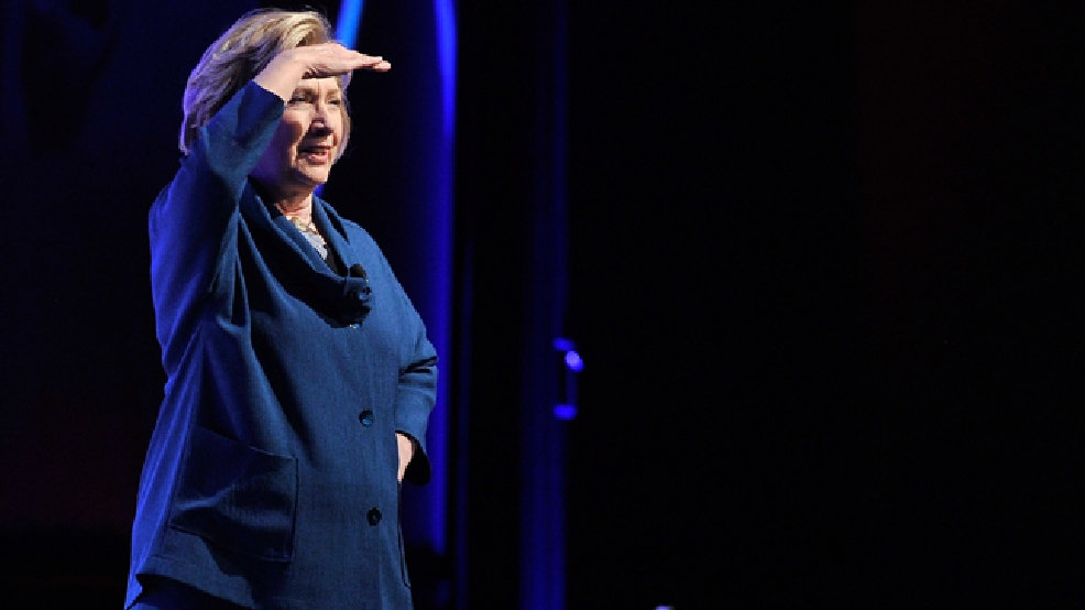 Former U.S. Secretary of State Hillary Rodham Clinton looks into the crowd after a person threw an object at her while speaking during The Institute of Scrap Recycling Industries' annual conference at the Mandalay Bay hotel-casino on Thursday, April 10, 2014, in Las Vegas. (AP Photo/Las Vegas Review-Journal, David Becker)