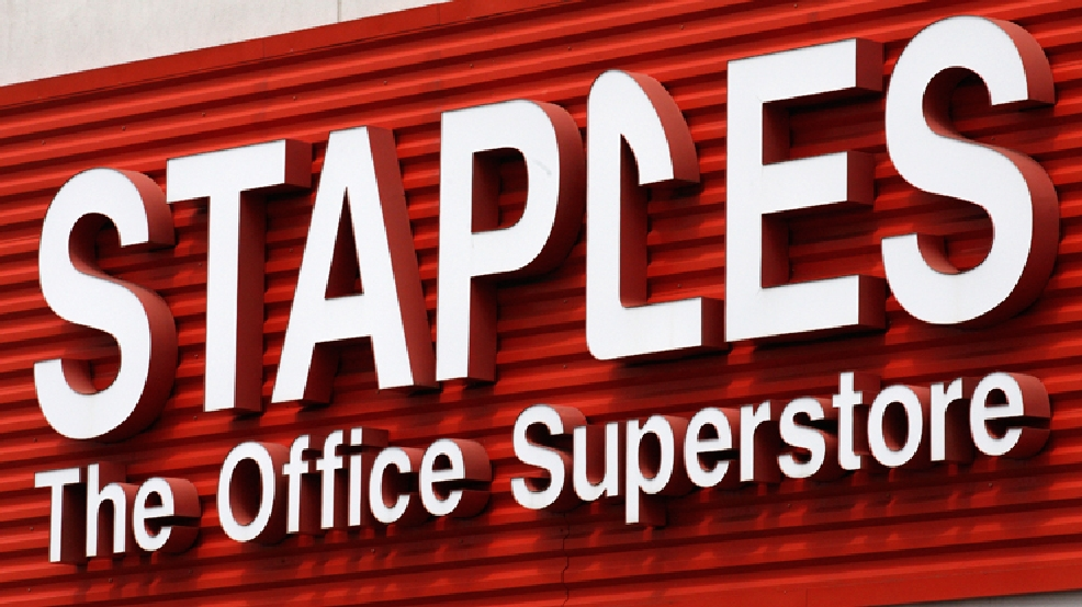FILE - In this May 17, 2011 file photo, a Staples sign is displayed on the front of a Staple store, in Portland, Ore. Staples says it will shutter 225 North American stores, about 10 percent of Staples Inc.'s worldwide total of 2,200, by the end of 2015, and the office-supply retailer has started a plan to save about $500 million annually. (AP Photo/Rick Bowmer, File)