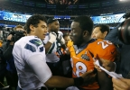 Former Wisconsin teammates Seattle Seahawks' Russell Wilson, left, greets Denver Broncos' Montee Ball after the NFL Super Bowl XLVIII football game Sunday, Feb. 2, 2014, in East Rutherford, N.J. The Seahawks won 43-8. (AP Photo/Paul Sancya)