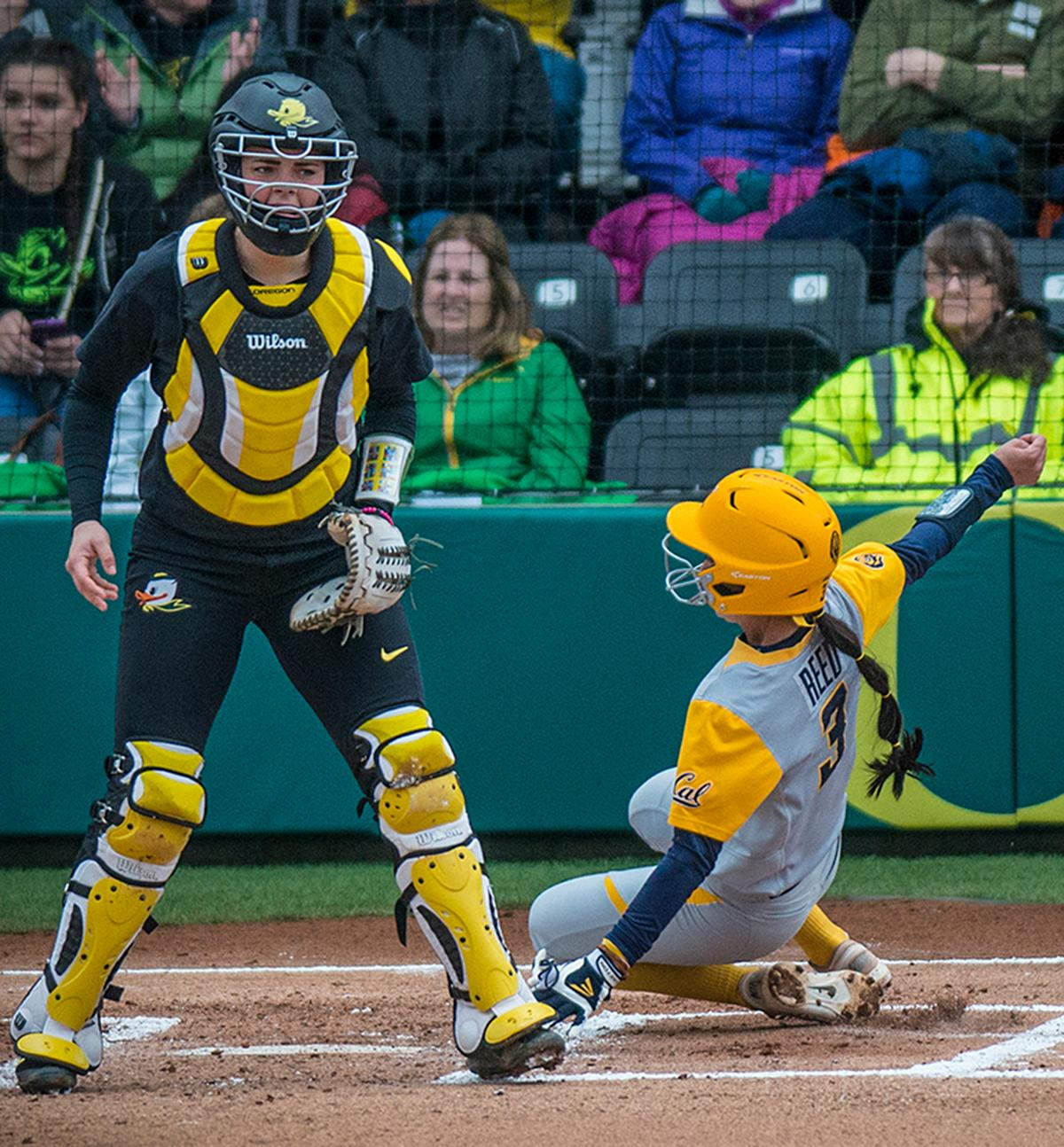 Cal Bears Kylie Reed (#3) slides into home base and scores the only run for Cal. The Oregon Ducks defeated the Cal Bears 2-1 in game two of a three-game series. Photo by Rhianna Gelhart, Oregon News Lab