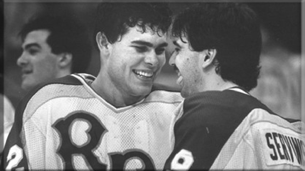 Adam Oates and George Servinis celebrate RPI's 2-1 victory against Providence in the 1985 NCAA Men's Hockey championship. (CourtesyRensselaer Polytechnic Institute Archives)
