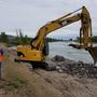 Emergency levee repair along the Snake River; homes threatened