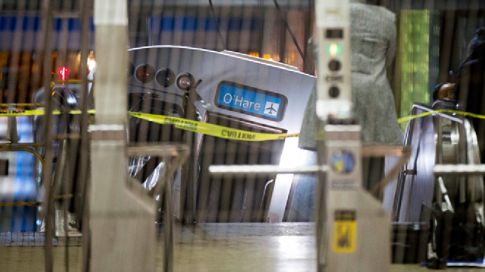 A derailed Chicago Transit Authority train car rests on an escalator at the O'Hare Airport station early Monday, March 24, 2014, in Chicago. More than 30 people were injured after the eight-car train plowed across a platform and scaled the escalator at the underground station. (AP Photo/Andrew A. Nelles)