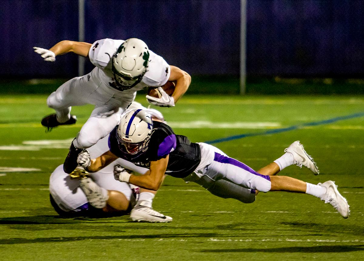 Sheldon's Matthew Burgess (#8) attemps to jump over a south player. Sheldon defeated South 63-6 at South Eugene on Friday. Photo by August Frank, Oregon News Lab