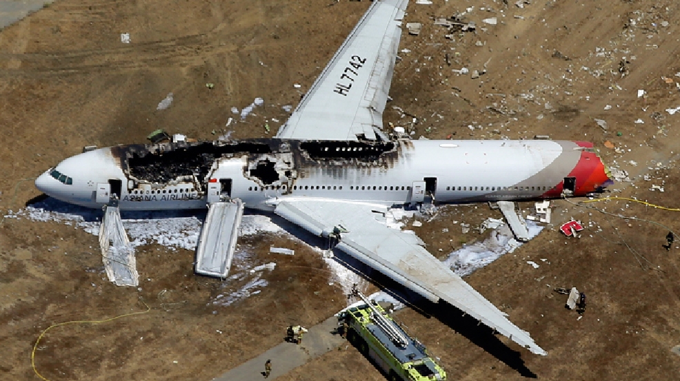 FILE - In this July 6, 2013 aerial file photo, the wreckage of Asiana Flight 214 lies on the ground after it crashed at the San Francisco International Airport in San Francisco. (AP Photo/Marcio Jose Sanchez, File)