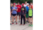 This year's Boston Marathon winner Meb Keflezighi (center) with other runners on Friday, June 13, 2014. (WLUK/Pauleen Le)