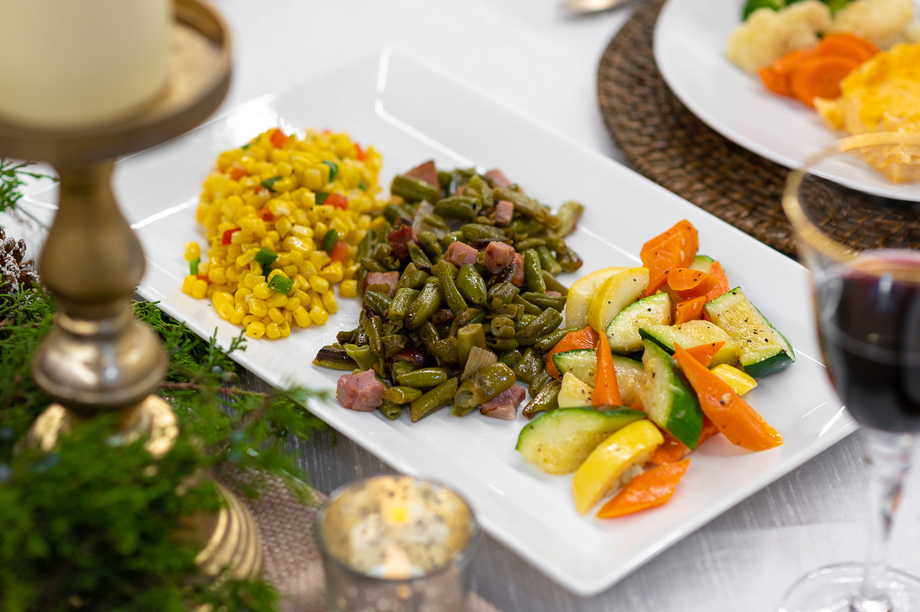 Plattered accompaniments elevate both the Holiday Dinner Buffet and Take and Bake dinners. Pictured: vegetable medley, country-style green beans, and corn with bell peppers. / Image: Phil Armstrong, Cincinnati Refined // Published: 11.6.20
