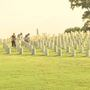 Volunteers remove flags at Chattanooga National Cemetery
