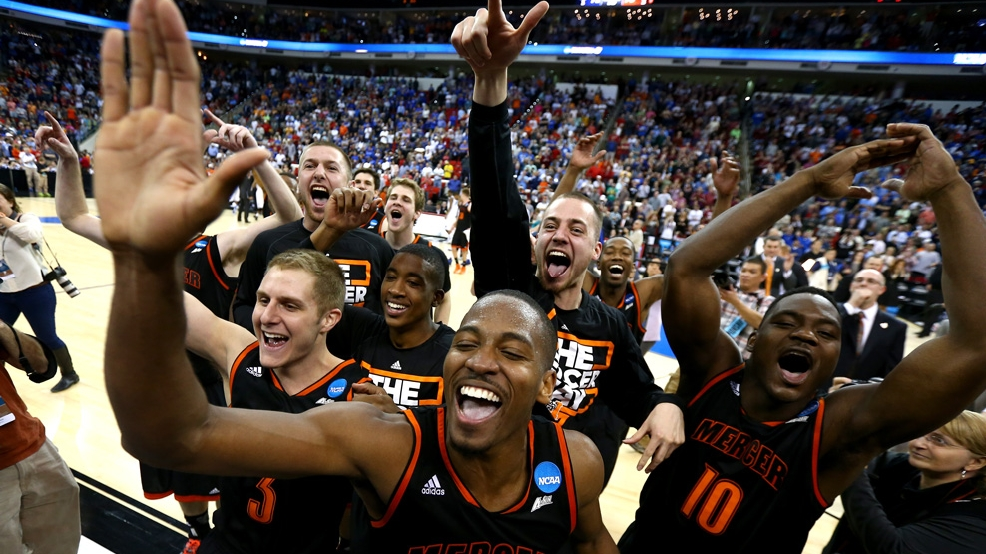 Mercer's Langston Hall and Ike Nwamu (10) celebrate with teammates after the Bears upset Duke 78-71 in the second round of the 2014 NCAA Men's Basketball Tournament on March 21, 2014, at PNC Arena in Raleigh, N.C. (Photo by Streeter Lecka/Getty Images)