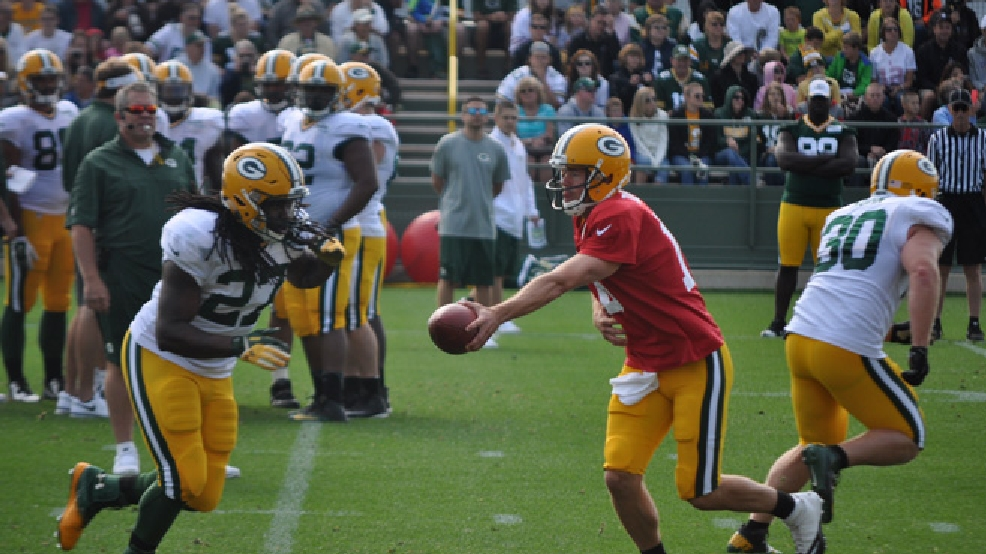 Green Bay Packers quarterback Scott Tolzien hands off to running back Eddie Lacy during training camp practice, July 28, 2014. (WLUK/John Doran)