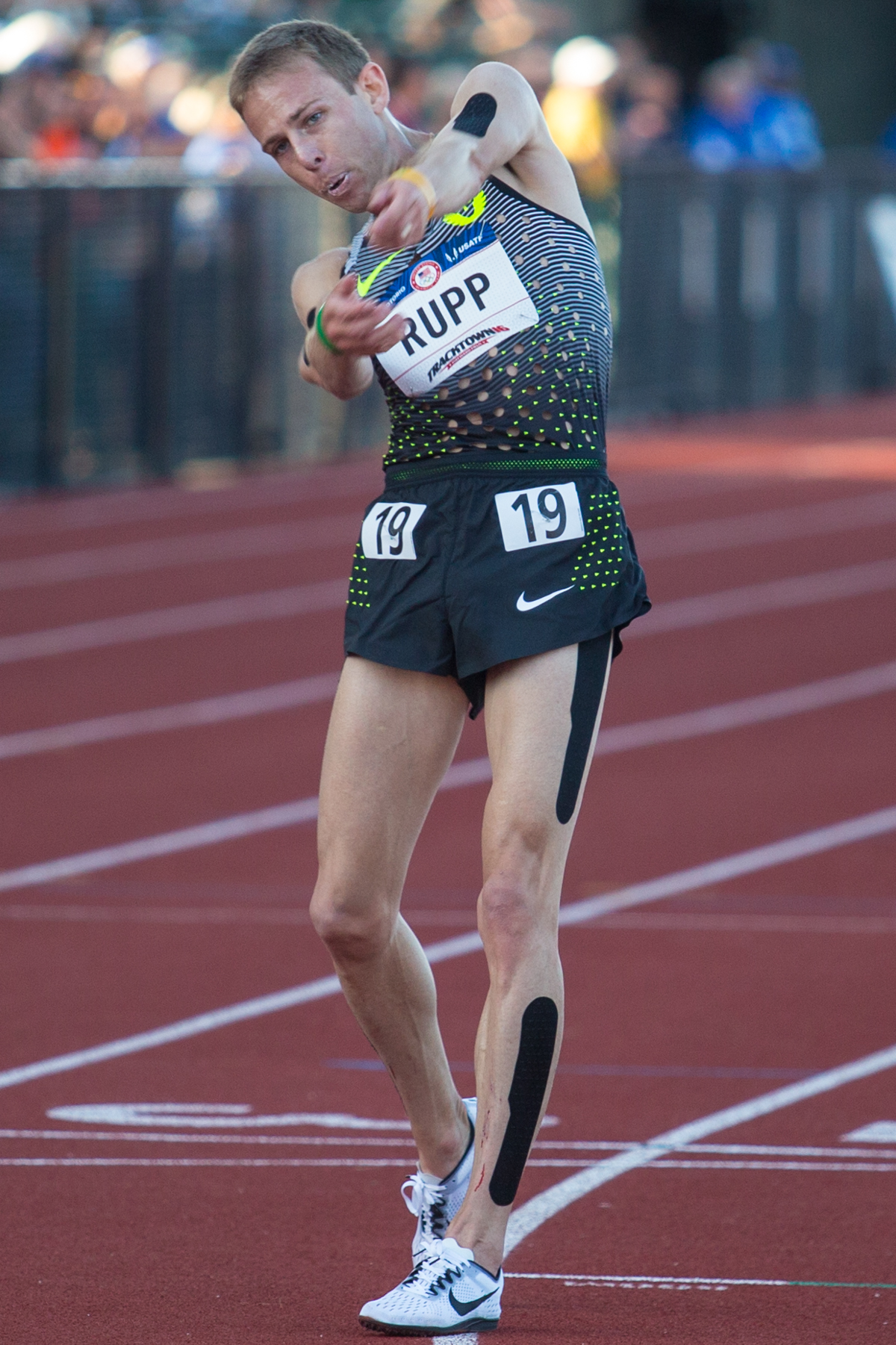 Former Oregon Duck Galen Rupp celebrates after winning the men�s 10,000m. He already made the team in the marathon but plans to double in the 10,000m and possibly the 5,000m as well. Photo by Dillon Vibes