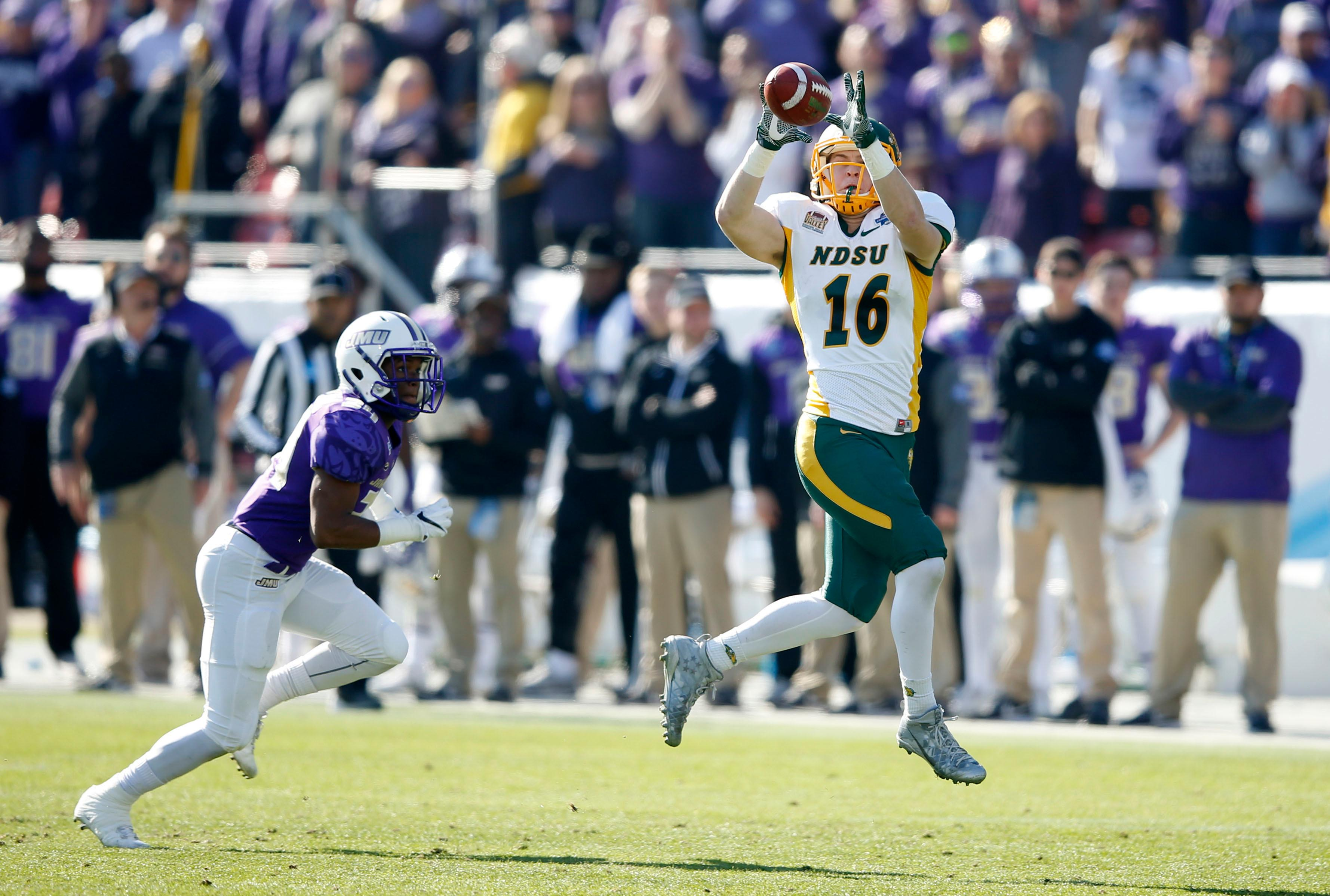 North Dakota State wide receiver RJ Urzendowski (16) catches a pass in front of James Madison cornerback Justin Bethea (34) during the first half of the FCS championship NCAA college football game at Toyota Stadium in Frisco, Texas, Saturday, Jan. 6, 2017. (Vernon Bryant/The Dallas Morning News via AP)