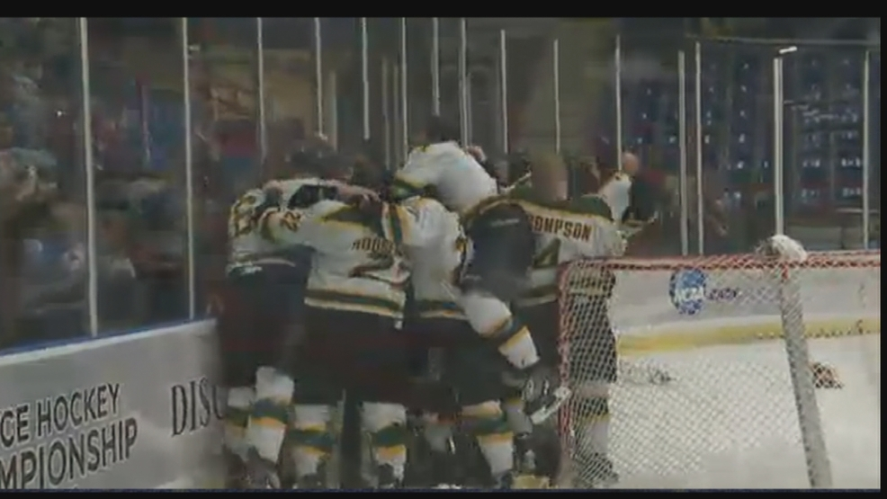 The St. Norbert hockey team celebrates after winning the Division III national championship.