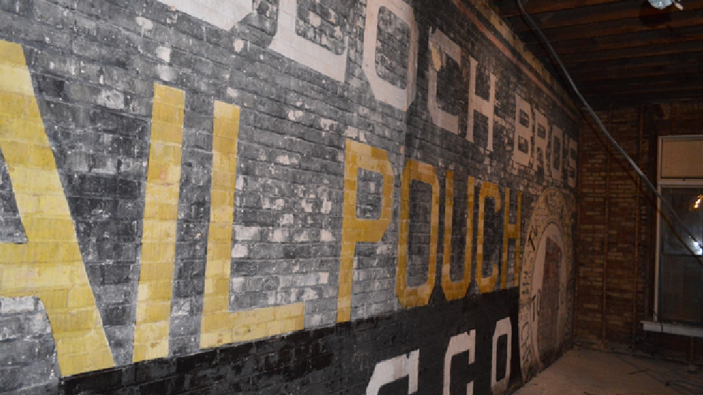A sign for Mail Pouch Tobacco is exposed during remodeling of the former Conkey's bookstore building in downtown Appleton, spring 2014. (Photo courtesy Will Weider)