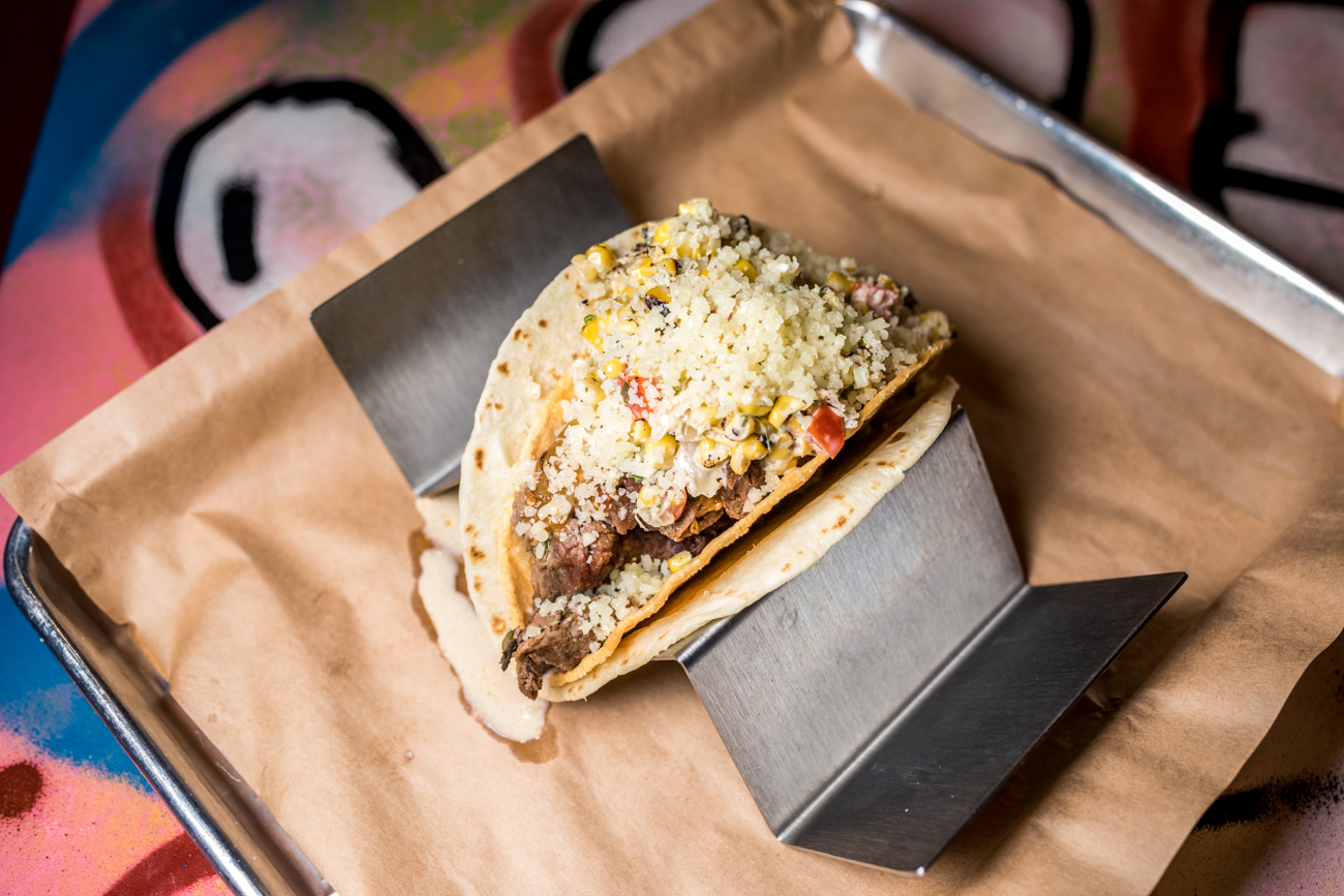 The Alderman: carne asada steak, street corn salad, cotija cheese ,and spicy chile de arbol salsa / Image: Catherine Viox{ }// Published: 12.13.20
