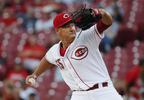 Cincinnati Reds starting pitcher Robert Stephenson winds up during the first inning against the Milwaukee Brewers, Tuesday, Sept. 5, 2017, in Cincinnati.