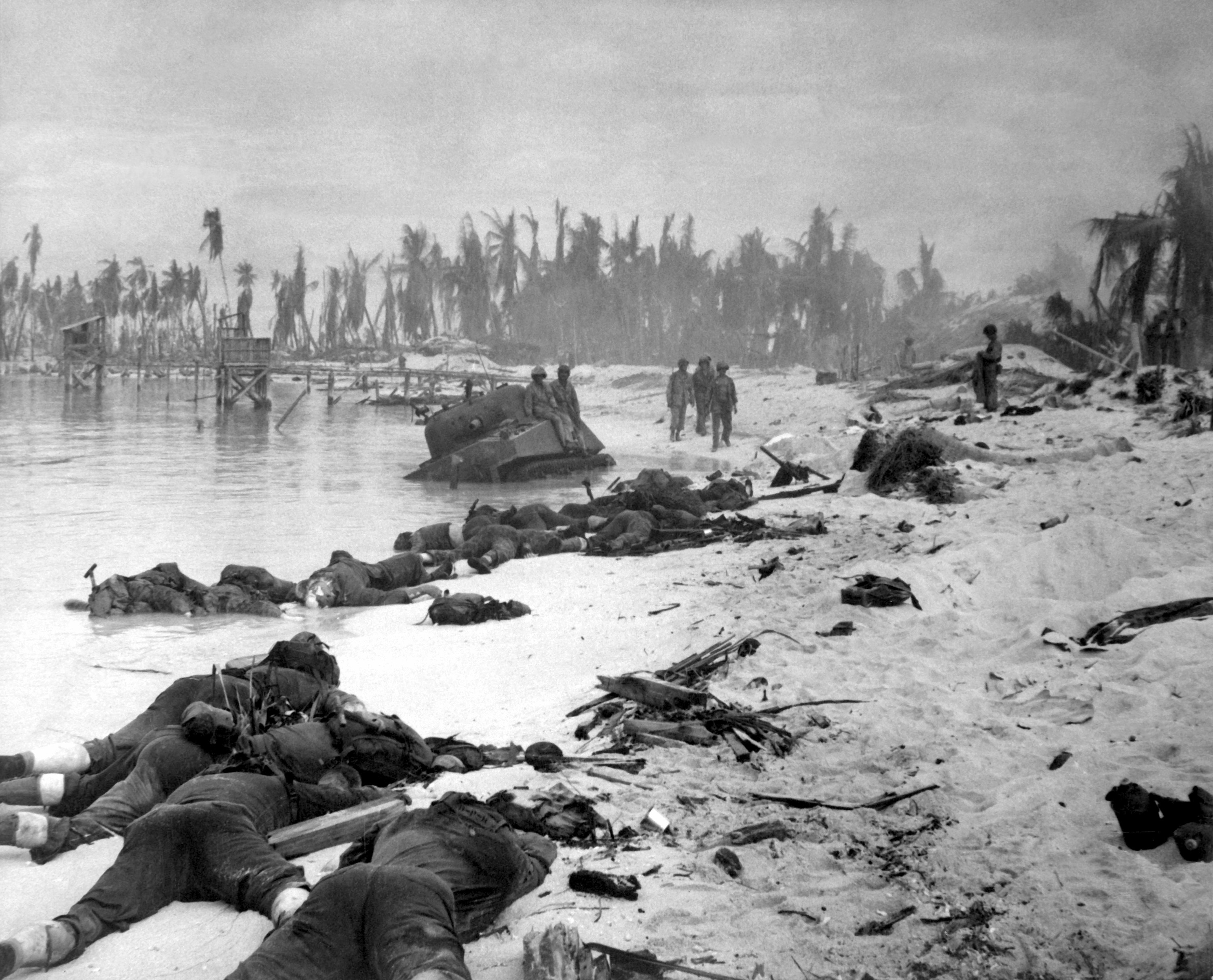 Sprawled bodies on beach of Tarawa, testifying to ferocity of the struggle for this stretch of sand.  November 1943.{ } (Photo: U.S. Navy archives)