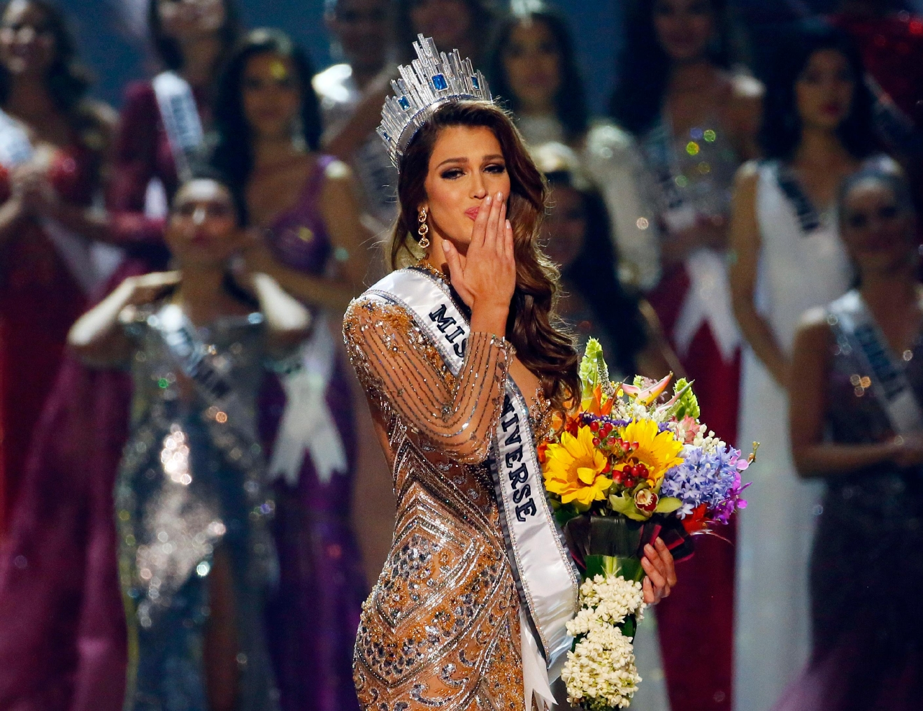Iris Mittenaere of France blows kisses to the crowd after being proclaimed the Miss Universe 2016 in coronation Monday, Jan. 30, 2017, at the Mall of Asia in suburban Pasay city, south of Manila, Philippines. (AP Photo/Bullit Marquez)