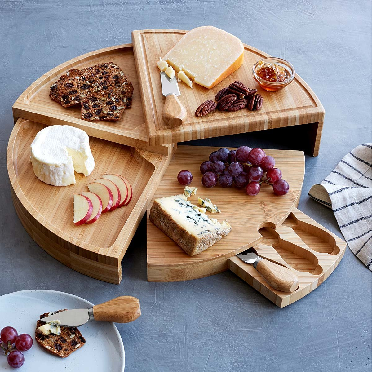 <p>This bamboo cheese board converts to a multi-level wheel and incorporates storage for serving tools. Perfect for hosting!$40-$64. (Image:{&nbsp;}Uncommongoods.com){&nbsp;}</p><p></p>
