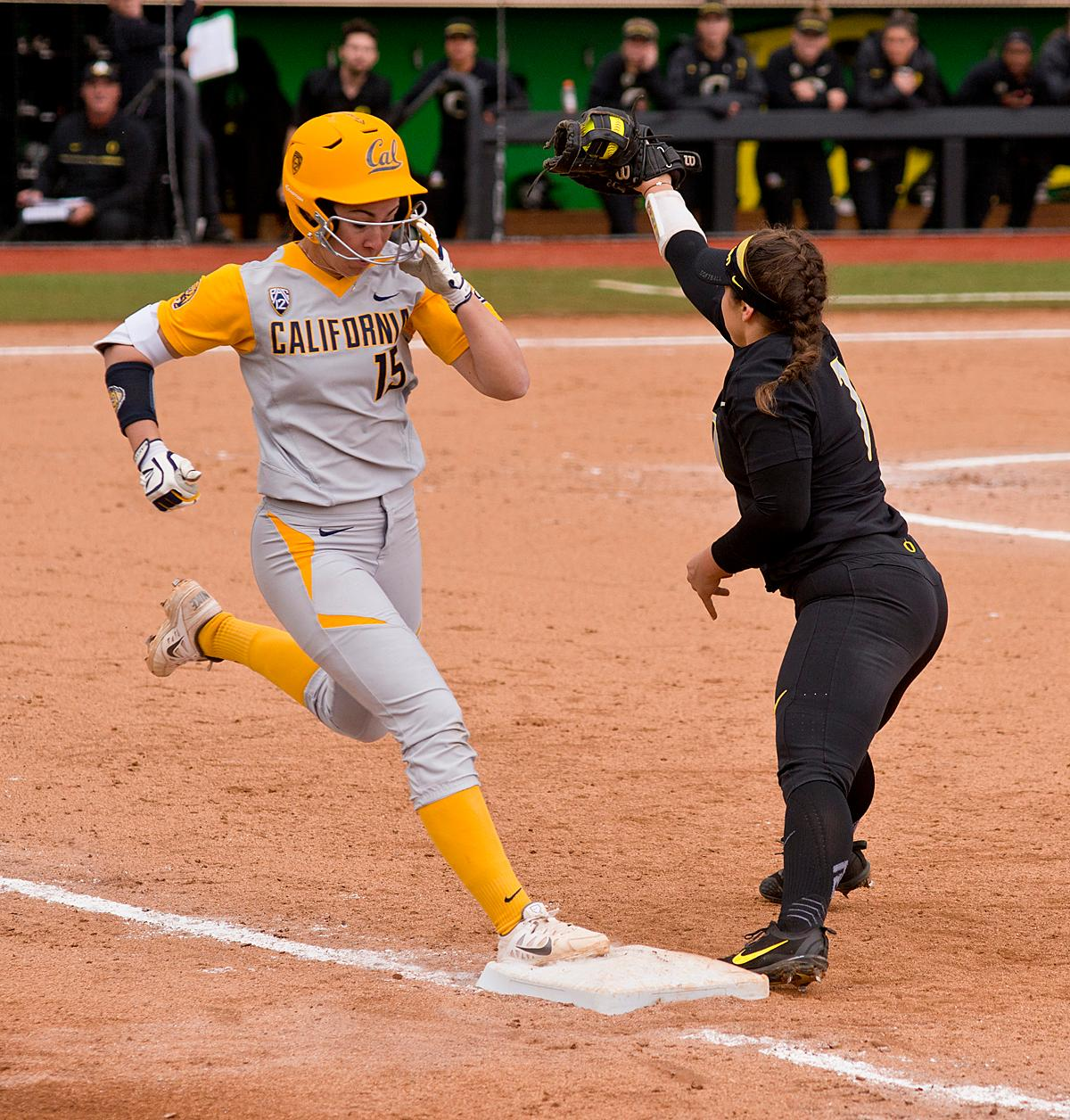 California Golden Bears Lindsay Rood (#15) is put out at first by Oregon Ducks first base player Mia Camuso (#7). The Ducks defeated the Golden Bears 2-1 in the second game of a three-game series Saturday. Photo by Dan Morrison, Oregon News Lab
