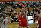 Oconto Falls' McKenna Larsen takes a shot in the lane against New London during their game Tuesday. (Doug Ritchay/WLUK)