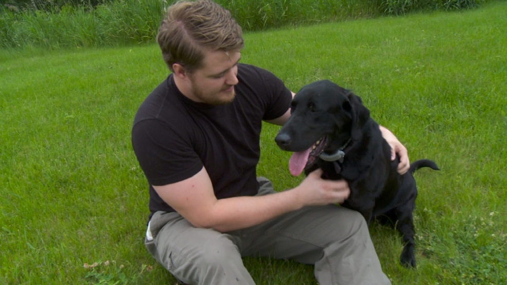 Corporal Jordan Serr with his dog Ccash